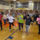 Elmwood Park students at St. Leo's dance in the dance-a-thon for Catholic Schools Week.