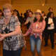Guests dance the night away at Saddle Brook Scouts' hoedown event.