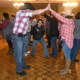 The dance floor comes to life at Saddle Brook Scouts' hoedown event.