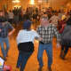 Dancers swing their partner around at Saddle Brook Scouts' hoedown event.