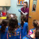 Daisy Troop 96912 girls listen as they learn about how Franklin Lakes Animal Hospital treats wildlife.