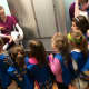 Girls from the Daisy Troop learn about wellness visits.
