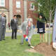 Eastchester Schools Superintendent Walter Moran planting the first sakura cherry tree.