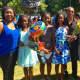 Graduates pose with family members.