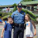 Mahwah Police Officer William Hunt and offspring at Ridgewood's Fourth of July parade.