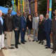 Mount Vernon Mayor Richard Thomas alongside several local officials at the grand opening of the new sculpture outside the Children's Room at the Mount Vernon Public Library.