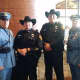 Police officers from New Rochelle and Dallas.
