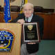 Dr. John F. Salimbene, who served as the Tuckahoe Police Department's surgeon for five decades, was killed in a house fire last weekend.  He is shown at an award ceremony in May where he was presented with a plaque.