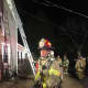 Firefighters from the Bethel and Stony Hill departments respond to a fire Saturday evening on Walnut Hill Road.