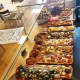 Pizza Mia in Newburgh always has a large assortment of pies on hand.