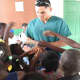 Vittorio Mena greets children at a clinic in Haiti in August of 2014.