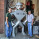 Glen Mills and Bill Gesner flank the tin man in their Hillsdale sheet metal shop.