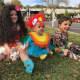 Kids dressed as Scarlett, Isaiah, and Harper.