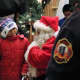 Austin, 8 of Moonachie, was surprised by firefighters and Santa Claus on Saturday.