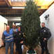 Success! John, Jose, Sgt. Sofia Gulino and Officer Chris Wasilewski get the tree set up at the Open Door Shelter in Norwalk.