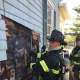 Fairfield firefighters tackled a fire burning inside a wall of a home on Stratfield Road on Thursday.