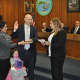 P.O. Daniel Anfang taking the oath of office with Town Clerk Raquel Ventura.