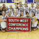 The Bethel High School girls basketball team celebrates its first South-West Conference championship Wednesday night.