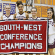 Bethel seniors (left to right) Sofia Orrico, Meggy Dolan, Amanda Towey, Madison Byrnes and Anne Bedore celebrate with the championship banner.