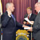 New Westchester County Police Officer Peter Carcaterra, takes the oath of office.