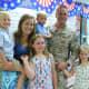 Orange County Executive Steve Neuhaus surprising children at a school assembly.