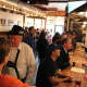 Owner Denis Maher, left in Tyrolean hat and lederhosen, mingles with the crowd at the Ambulance Brew House in Nanuet.