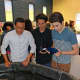 Pablo Parizot, right, a sophomore at Brien McMahon High School, demonstrates his team's underwater remotely operated vehicle (ROV) during an end-of- year celebration of the TeMPEST teen program. Looking on are Daniel Posadas and Juan Rosales.