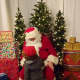 Santa hears the Christmas wishes of a Bronxville child at the recent village holiday celebration.