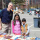 White Plains Mayor Tom Roach at last year's annual Free Book Celebration. More than 10,000 books have been collected for the fourth annual giveaway on Saturday at Eastview Middle School.