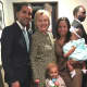 Mount Vernon Mayor Richard Thomas' family with presidential hopeful Hillary Clinton at Grace Baptist Church on Sunday.