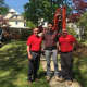 """Jonathan Drew of HGTV's """"Property Brothers,"""" center, poses with employees of Curti Landscaping, from left, Dave Rosenfeld and TJ Farkas."""