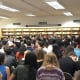 More than 100 government and microeconomics students take part in the recent #DemocracyIsNotASpectatorSport civics forum at New Rochelle High School.