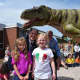 Bergen County Executive James Tedesco, Parkway School students and a T-Rex pose together on Wednesday.
