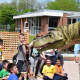 Parkway students check out the dinosaur.