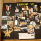 A display board showing Victori's journey to Eagle Scout.