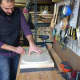 Henry D'Allacco crafts each instrument by hand at Grosbeak Guitars.