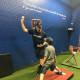 Patrick Stanley works with an athlete at Complete Game baseball and softball instruction facility in Allendale.