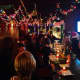 """Tinsel and Santa hats reign at the holiday pop-up bar """"Miracle on Wall Street"""" in Norwalk, Conn."""