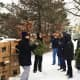 Members of the Wyckoff Area Garden Club and other volunteers prepare to lay wreaths on veteran graves earlier this month.