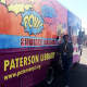 Ms. Maisy, an outreach librarian, poses by the Bookmobile in 2016.