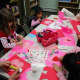 Volunteers of East Rutherford Library's Random Acts of Kindness Club make Valentines.