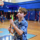 A fourth-grade pupil at F.E. Bellows Elementary School spins a plate in gym class.
