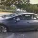 The suspect in a Monroe bank robbery fled in this newer model gray Honda Civic.