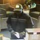 The suspect in the Friday robbery of the Newtown Savings Bank on Main Street/Route 25 was described as a black male in all dark clothing and a baseball hat.