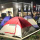 Dozens of people camp out overnight before the grand opening Thursday of the new Chick-Fil-A in Norwalk.