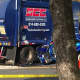 The scene of a fatal crash involving a garbage truck and a car in front of Mamaroneck High School on Saturday morning.