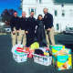 Members of the Dumont Police Department and Daily Voice managing editor Cecilia Levine prepare to bring some supplies to the Roman family Tuesday.