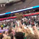 Pleasantville fans cheer wildly as players display the state title trophy.