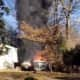 A fire broke out in a boat and trailer, leaving an Airmont home with damage.