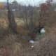 First responders head for a car that rolled down an embankment off Exit 7 of I-84 eastbound in Danbury on Wednesday morning.